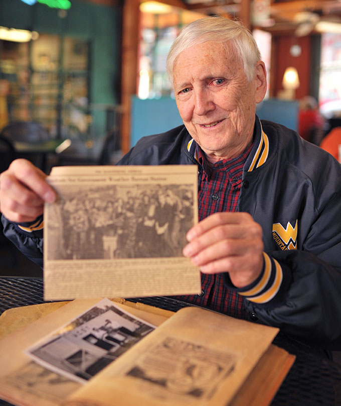 Henry Ruppenthal enjoyed celebrity status as a teenager as a result of being a cooperative weather observer for Morgan County, W.Va. He holds a clipping of a class field trip at which Henry was the speaker.