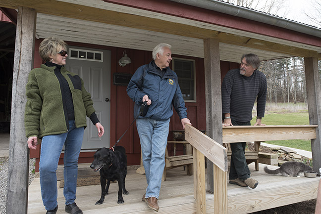 WV Department of Agriculture Commissioner Walt Helmick and his wife Rita Fay talk to Chatman Neely (right) on the porch of the bed and breakfast room where the couple stayed the night before. Barn With Inn has three rooms, one in a hay loft, one in a former horse stall and one in the innkeepers' home.